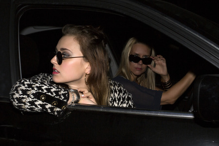 two women with sunglasses sitting in a car photo
