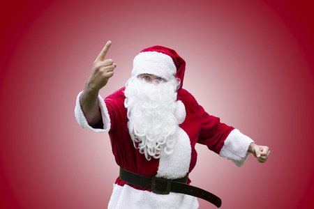 clenching: Santa Claus pointing his finger and clenching his fist Stock Photo