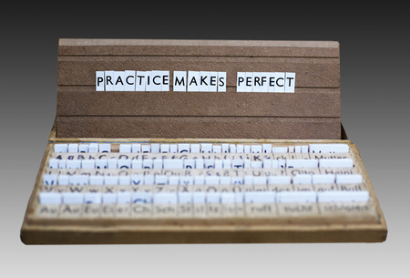 the words practice makes perfect on an old school letter box photo
