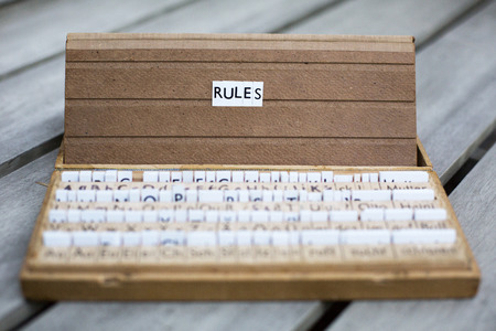 the word rules on an old school letter box photo