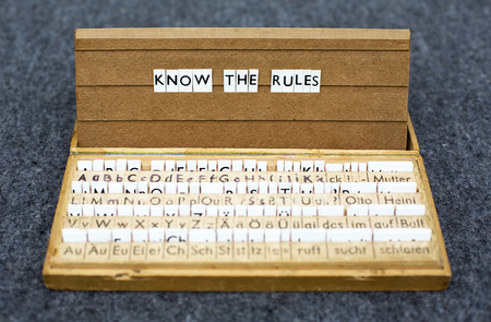 the words know the rules on an old school letter box photo