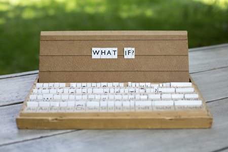 what if: the word what if? on an old school letter box