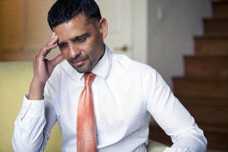 pakistani pakistan: handsome businessman looking thoughful Stock Photo