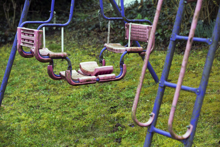 swing set: old dirty swing set on playground