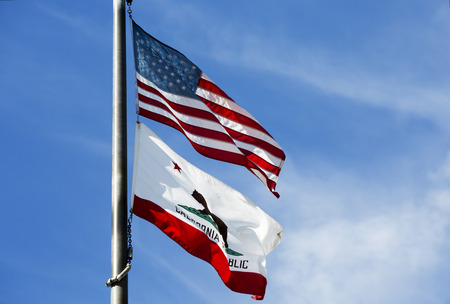 californian: flag pole with the american and californian flag Stock Photo