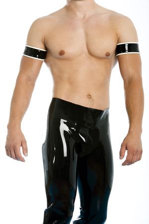 latex fetish: muscular man in latex pants and torso Stock Photo