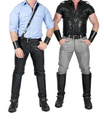 two muscular men standing in fetish gear