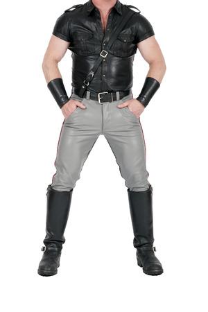 muscual Leatherman staande in fetish gear Stockfoto