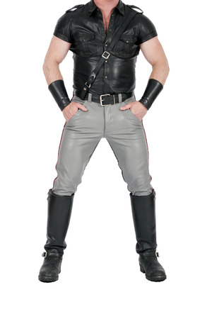 muscual leatherman standing in fetish gear