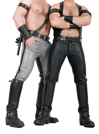 human chest: two muscular leathermen dressed in fetish gear Stock Photo