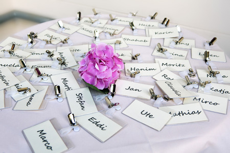 name day: bunch of nametags scattered on a table Stock Photo