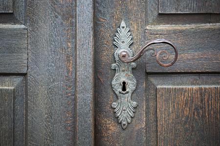 old wooden entrance door with antique door handle photo