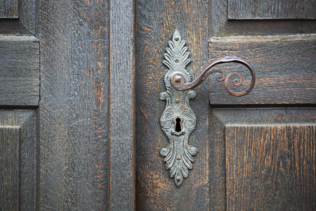 vintage door: old wooden entrance door with antique door handle