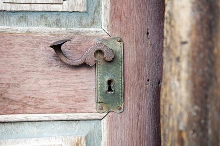 old colourfull wooden entrance door with antique door handle Stockfoto