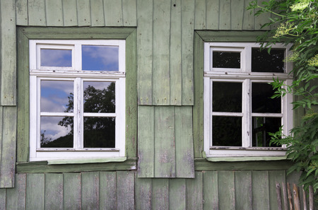 old windows: two old windows of a vintage wooden house Stock Photo
