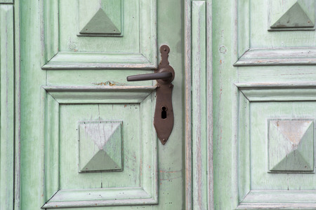 old green wooden entrance door with antique door handle photo & Old Wooden Entrance Door With Antique Door Handle Stock Photo ...