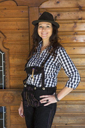 wiesn: woman in bavarian traditional clothes standing at a door