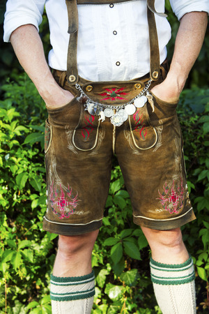 leather pants: man in traditional bavarian leather pants standing outdoors Stock Photo