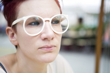 redhaired: portrait of red-haired caucasian woman wearing white glasses Stock Photo