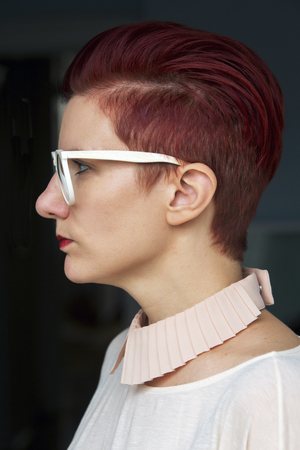 woman profile: side profile of a beautiful red-haired woman with white glasses Stock Photo
