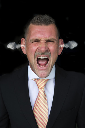 coming out: Portrait of an angry businessman with steam coming out of his ears Stock Photo
