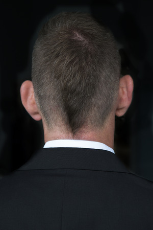 backside: backside of a businessman with short hipster haircut Stock Photo