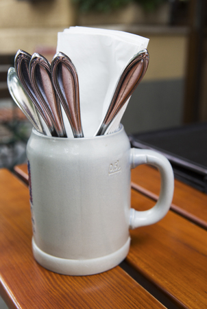 silverware: beer mug with silverware on a table