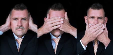businessman posing as the three wise monkeys