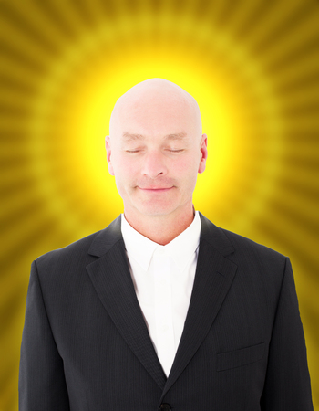 pretender: bald businessman with a yellow halo and eyes closed Stock Photo