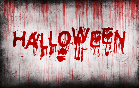 grungy: Halloween painted on a grungy bloody wall Stock Photo
