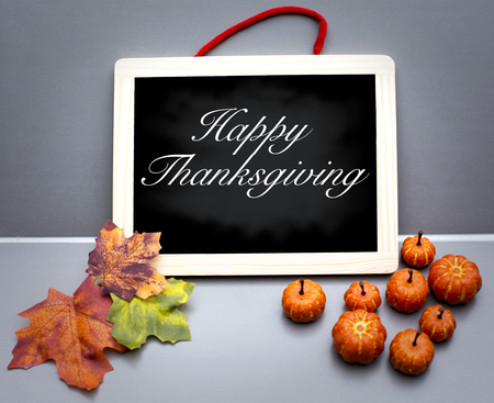 happy thanksgiving: Happy Thanksgiving on wooden board with pumpkins and leaves Stock Photo