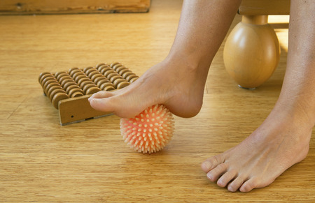 healthy women: foot in with rubber massage ball