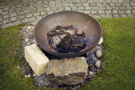the ashes: fireplace with burned firewood and ashes