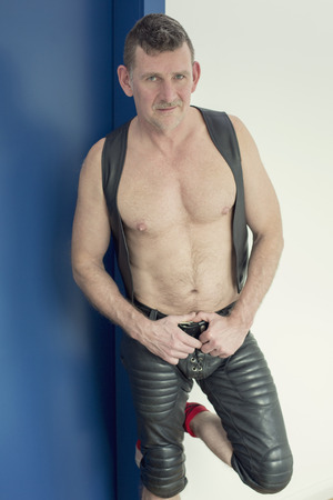 sm: portrait of man wearing black fetish leather clothes Stock Photo