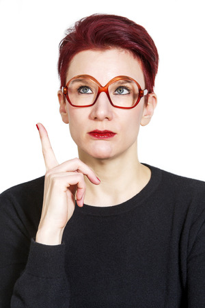 redhaired: portrait of red-haired woman looking thoughtful Stock Photo