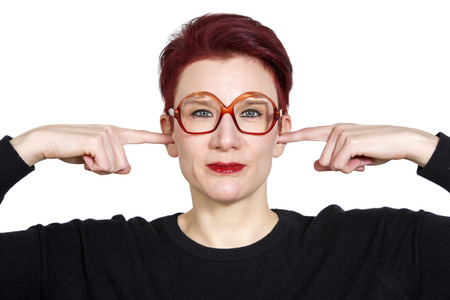 portarit: portarit of red-haired woman with big glasses holding her fingers to her ears