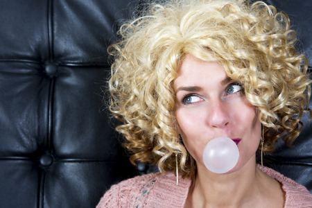portarit: portarit of curly blond woman with bubblegum
