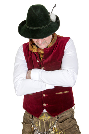 lederhose: isolated portrait of bavarian man in traditional clothes looking down