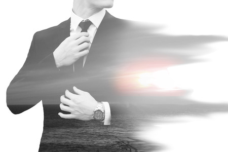 artisitc: double exposure of businessman and ocean with sunset Stock Photo