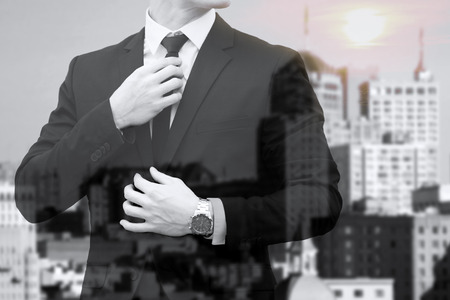 artisitc: double exposure of businessman and skyline