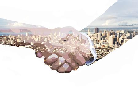 double exposure of handshake and skyline of San Francisco