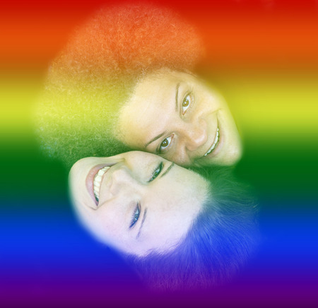 gay girl: two women smiling and rainbow colors for gay pride Stock Photo