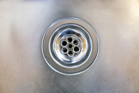 stainless steel sink: close up of a stainless steel sink plug hole Stock Photo