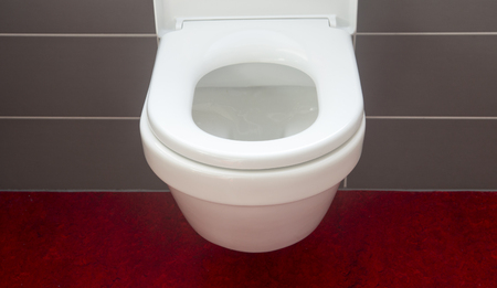 lid: closeup of white toilet bowl and open lid cover Stock Photo