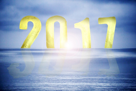 yellow numbers 2017 as ice cubes with sunset over blue ocean Stock Photo