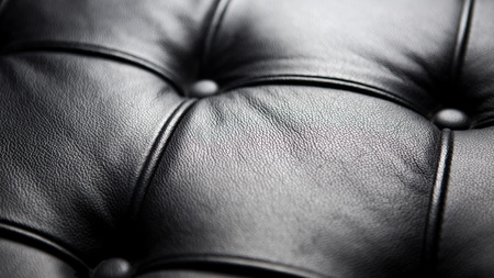 closeup of luxurious black leather couch