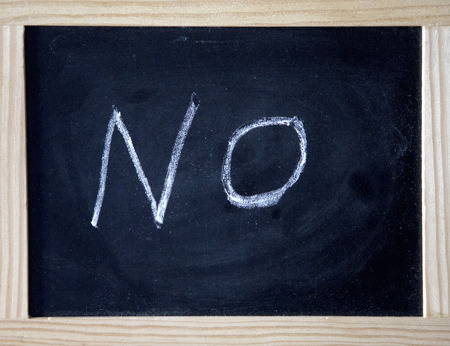 the word No written on black chalk board