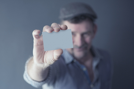 businesscard: handsome man showing an empty businesscard