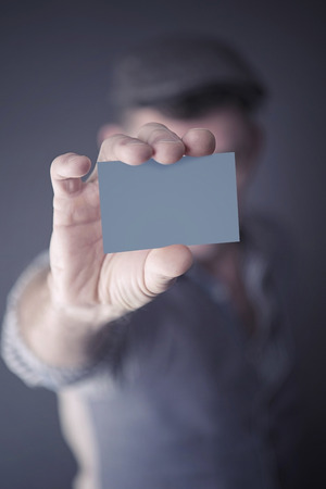 businesscard: stylish handsome man showing an empty businesscard