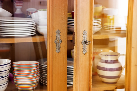 closeup of vintage cabinet with plates and bowls Stock Photo